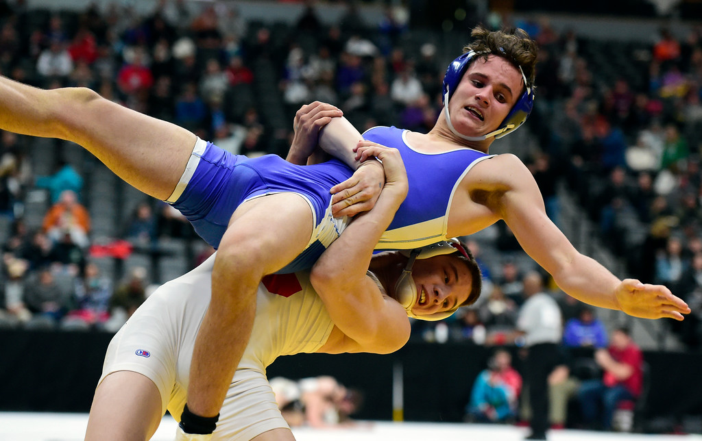 . Longmont High School\'s Brayden Engelking gets slammed by Pueblo Centennial\'s Cole Hernandez during a 4A 145-pound first round match during day 1 of the CHSAA State Wrestling Tournament at the Pepsi Center in Denver. More photos: BoCoPreps.com Jeremy Papasso/ Staff Photographer 02/15/2018