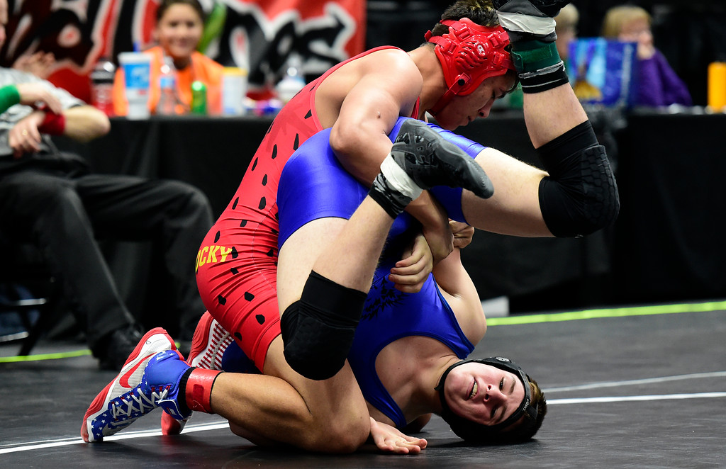 . Lyons High School\'s Konner Mauck tries to avoid being pinned by Rocky Ford\'s Jesse Tapia during a 2A 170-pound first round match during day 1 of the CHSAA State Wrestling Tournament at the Pepsi Center in Denver. Mauck lost the match. More photos: BoCoPreps.com Jeremy Papasso/ Staff Photographer 02/15/2018