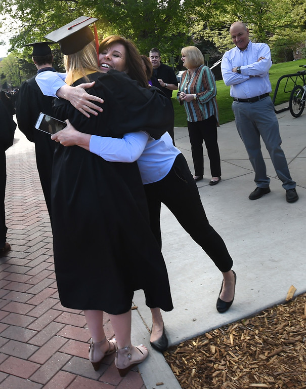 . CU grad McKenzie Dennis gets a hugs from Gretchen Richard before the 2018 CU Commencement on May 10, 2018.  For more photos and a video, go to dailycamera.com. Cliff Grassmick  Photographer  May 10,  2018