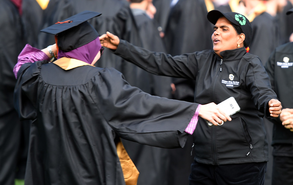 . Fatin Kamaruzaman, left, is about to hug Nur Kashid before  the 2018 CU Commencement on May 10, 2018.  For more photos and a video, go to dailycamera.com. Cliff Grassmick  Photographer  May 10,  2018