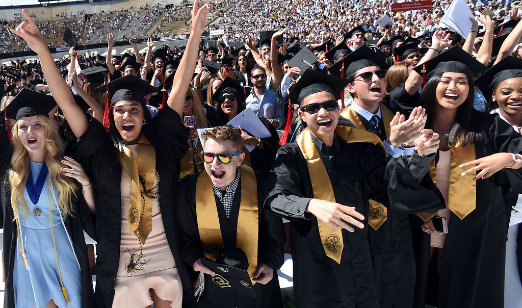 . Ariana Freeman, left, Jake Shapiro, Nathan Tung,Bobby Gehlen, Chanelle Tong, and Brecca Thomas, celebrate during the 2018 CU Commencement on May 10, 2018.  For more photos and a video, go to dailycamera.com. Cliff Grassmick  Photographer  May 10,  2018
