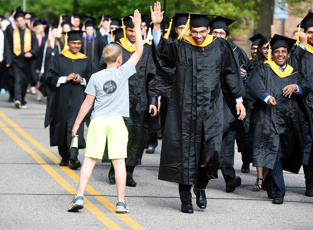 . Declan Noonan,11, high-fived as many graduates as he could before  the 2018 CU Commencement on May 10, 2018.  For more photos and a video, go to dailycamera.com. Cliff Grassmick  Photographer  May 10,  2018