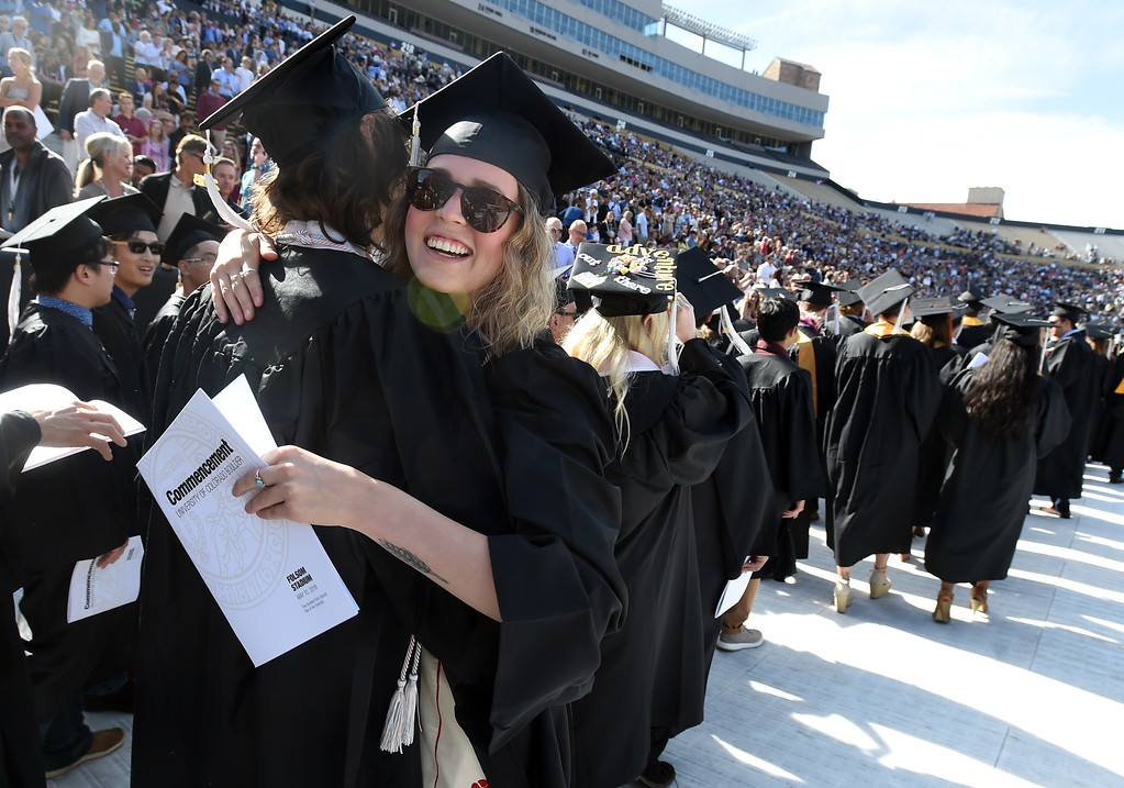 . Hope Ruskaup gets a hug from Damian Borovski during the 2018 CU Commencement on May 10, 2018.  For more photos and a video, go to dailycamera.com. Cliff Grassmick  Photographer  May 10,  2018