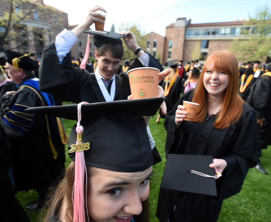 . Bebecca Ramsey, bottom, Josef Fischer, and Allyson Stibbards, all music majors, have coffee before the 2018 CU Commencement on May 10, 2018.  For more photos and a video, go to dailycamera.com. Cliff Grassmick  Photographer  May 10,  2018