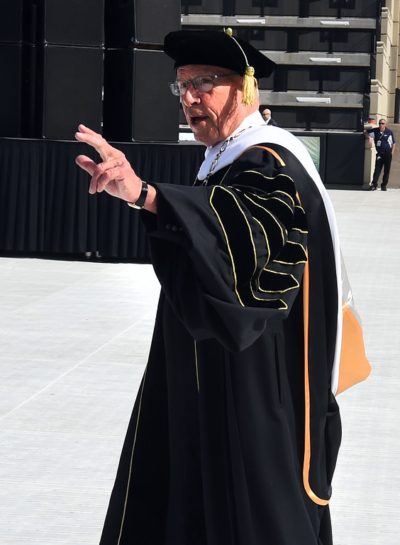 . CU President Bruce Benson acknowledges graduations as he enter the ceremony during the 2018 CU Commencement on May 10, 2018.  For more photos and a video, go to dailycamera.com. Cliff Grassmick  Photographer  May 10,  2018