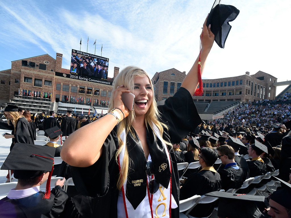 . Vonda Jane Westlake lets her family know where she is on Folsom Field during the 2018 CU Commencement on May 10, 2018.  For more photos and a video, go to dailycamera.com. Cliff Grassmick  Photographer  May 10,  2018