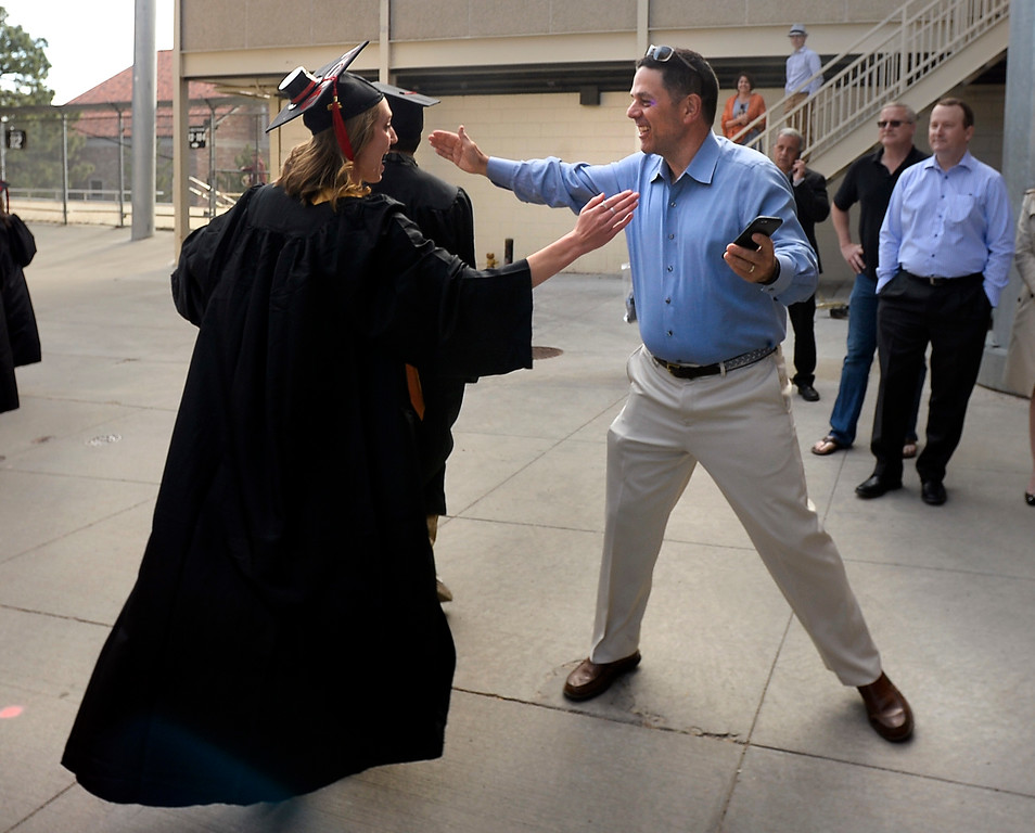 . Scott Wolfarth, left, hugs a family friend as she goes to Folsom Field during the 2018 CU Commencement on May 10, 2018.  For more photos and a video, go to dailycamera.com. Cliff Grassmick  Photographer  May 10,  2018