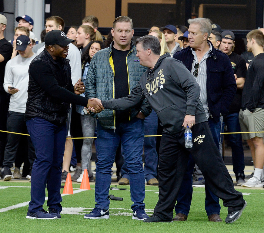 . Bronco head coach, Vance Joseph, left, is introduced to CU head coach, Mike MacIntyre, during the 2018 CU Pro Timing Day at the Indoor Practice Facility at the University of Colorado.  For more photos, go to Buffzone.com. Cliff Grassmick  Photographer  March 7, 2018