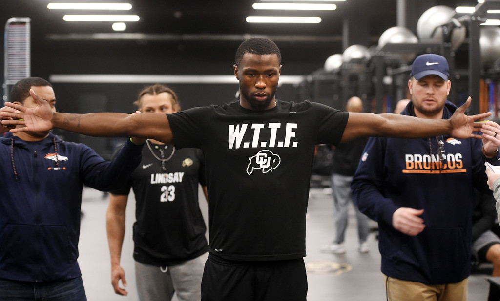 . Afolabi Laguda is measure by NFL scouts during the 2018 CU Pro Timing Day at the Indoor Practice Facility at the University of Colorado.  For more photos, go to Buffzone.com. Cliff Grassmick  Photographer  March 7, 2018