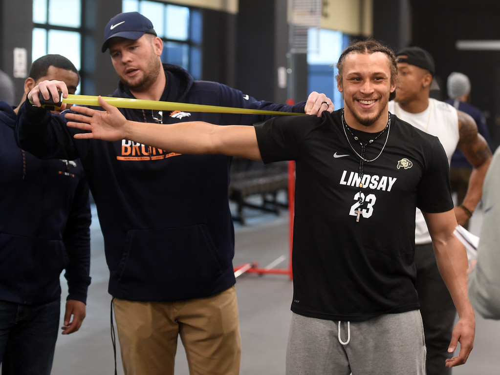 . Phillip Lindsay get measured during the 2018 CU Pro Timing Day at the Indoor Practice Facility at the University of Colorado.  For more photos, go to Buffzone.com. Cliff Grassmick  Photographer  March 7, 2018