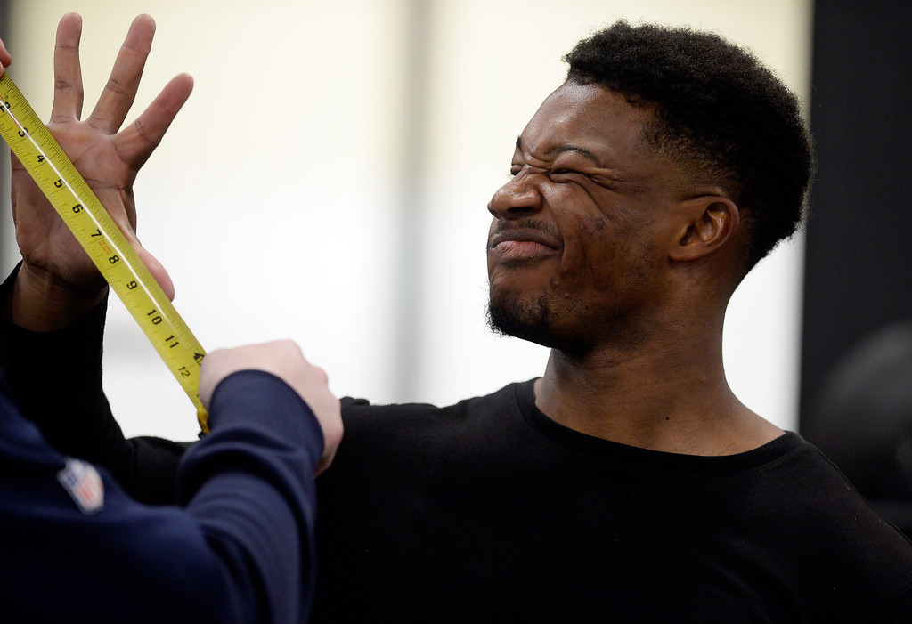 . Michael Adkins II grimaces while being measured during the 2018 CU Pro Timing Day at the Indoor Practice Facility at the University of Colorado.  For more photos, go to Buffzone.com. Cliff Grassmick  Photographer  March 7, 2018