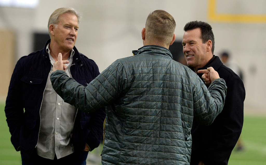 . Bronco GM, John Elway, and Gary Kubiak, listen to Bronco staffer, Matt Russell, during the 2018 CU Pro Timing Day at the Indoor Practice Facility at the University of Colorado.  For more photos, go to Buffzone.com. Cliff Grassmick  Photographer  March 7, 2018