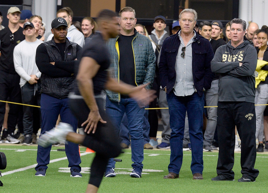. Bronco head coach, Vance Joseph, left, scout, Matt Russell, Bronco GM, John Elway, and CU head coach, Mike Macintyre, watch 40-yard dashes during the 2018 CU Pro Timing Day at the Indoor Practice Facility at the University of Colorado.  For more photos, go to Buffzone.com. Cliff Grassmick  Photographer  March 7, 2018