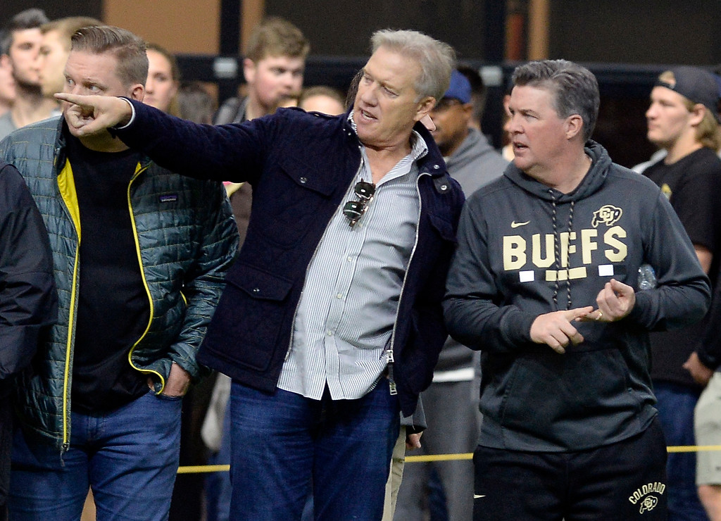 . Denver Bronco GM, John Elway and CU head football coach, MIke MacIntyre, compare notes during the 2018 CU Pro Timing Day at the Indoor Practice Facility at the University of Colorado.  For more photos, go to Buffzone.com. Cliff Grassmick  Photographer  March 7, 2018