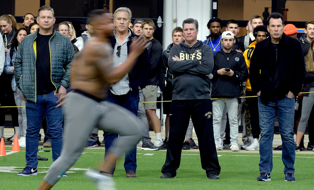 . Bronco scout, Matt Russell, left, Bronco GM, John Elway, CU head coach, Mike MacIntyre, and Bronco scout, Gary Kubiak, watch George Frazier V, run his 40-yard dash during the 2018 CU Pro Timing Day at the Indoor Practice Facility at the University of Colorado.  For more photos, go to Buffzone.com. Cliff Grassmick  Photographer  March 7, 2018