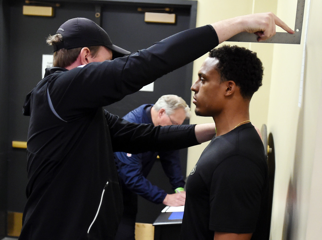 . Isaiah Oliver is measured by NFL scouts during the 2018 CU Pro Timing Day at the Indoor Practice Facility at the University of Colorado.  For more photos, go to Buffzone.com. Cliff Grassmick  Photographer  March 7, 2018