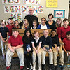 CLASS VISITS—Bishop Edward Rice visited each class during his Catholic School Week visit to St. Mary Catholic School in Joplin on Jan. 29. Here he is with Ann Hamlet and the third grade class. (<i>The Mirror</i>)