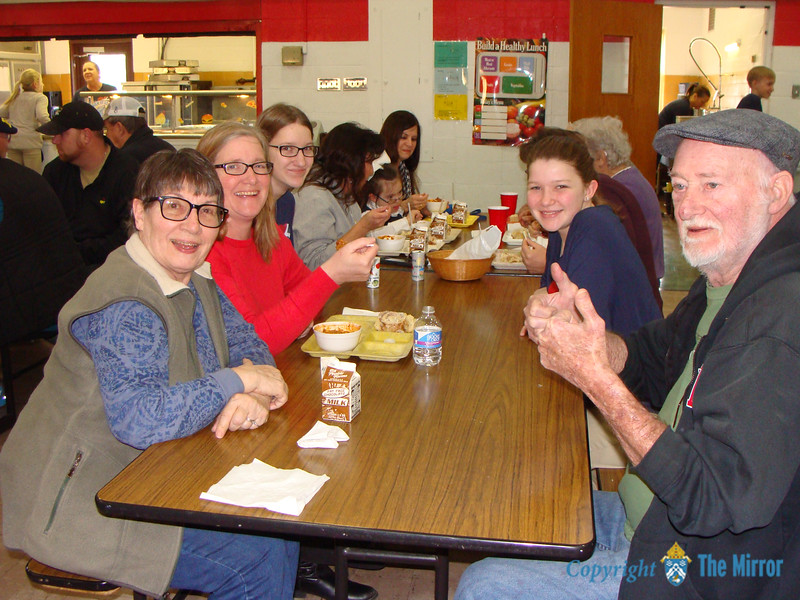 CINNAMON ROLLS & CHILI—Parents and grandparents joined students for lunch in Guardian Angel School, Oran, which included home-made cinnamon rolls and chili on Jan. 31 during Catholic Schools Week 2018. (<i>The Mirror</i>)