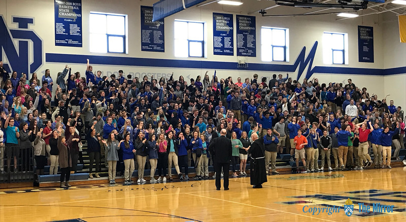 CATHOLIC SCHOOLS WEEK—Bishop Edward Rice and Bro. David Migliorino, OSF, principal, launched the games held Feb. 2 in Notre Dame Regional High School, Cape Girardeau, celebrating the gifts of Catholic Schools Week (CSW) after the annual CSW liturgy held with students. (<i>The Mirror</i>)