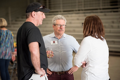 Rick Anderson (center) enjoys a conversation at the annual Chico Chapter Spring BBQ that is held at the University Farm on Thursday, April 26, 2018 in Chico, Calif.  (Jessica Bartlett/University Photographer)