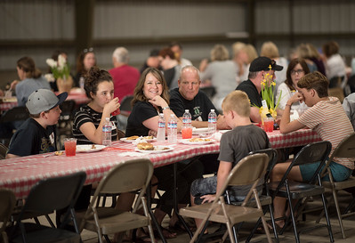 Tami Adams (center) enjoys the annual Chico Chapter Spring BBQ that is held at the University Farm on Thursday, April 26, 2018 in Chico, Calif.  (Jessica Bartlett/University Photographer)