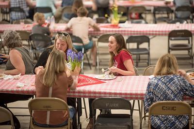 Kaitlin Ferguson (center) enjoys the annual Chico Chapter Spring BBQ that is held at the University Farm on Thursday, April 26, 2018 in Chico, Calif.  (Jessica Bartlett/University Photographer)