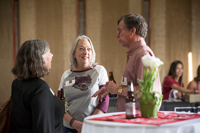 Kathleen Hassig (center) enjoys a conversation during the annual Chico Chapter Spring BBQ that is held at the University Farm on Thursday, April 26, 2018 in Chico, Calif.  (Jessica Bartlett/University Photographer)