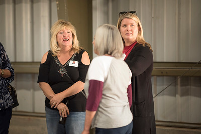 Wendy Needles (left) enjoys a conversation at the annual Chico Chapter Spring BBQ that is held at the University Farm on Thursday, April 26, 2018 in Chico, Calif.  (Jessica Bartlett/University Photographer)