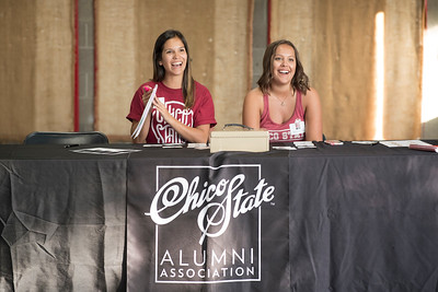 Students Selena Brewer (left) and Elise Slusarz (right) work at the annual Chico Chapter Spring BBQ that is held at the University Farm on Thursday, April 26, 2018 in Chico, Calif.  (Jessica Bartlett/University Photographer)