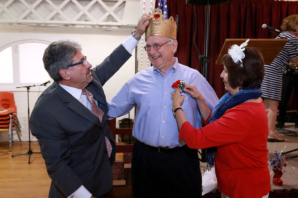 . The Annual Civic Days kick off celebration and appreciation was held at the Fitchburg Senior Center on Wednesday afternoon. This is the celebration were they pick the king and queen of Civic Days. Entertaining the crowd at the event was the Vinny Prendergast & the Sons of Blarney band. Mayor Stephen DiNatale crowns George J. Bourque II as this years king  as this years queen Susan Monsegur puts a corsage on him during the ceremony. SENTINEL & ENTERPRISE/JOHN LOVE