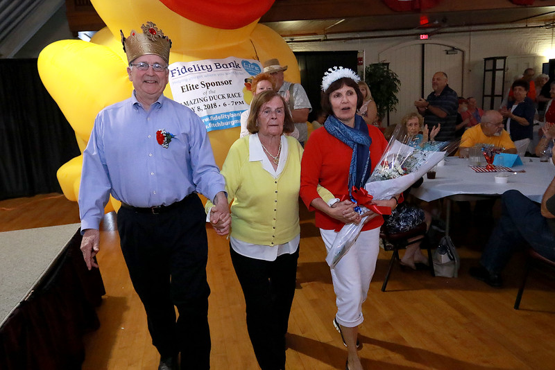 The Annual Civic Days kick off celebration and appreciation was held at the Fitchburg Senior Center on Wednesday afternoon. This is the celebration were they pick the king and queen of Civic Days. Entertaining the crowd at the event was the Vinny Prendergast & the Sons of Blarney band. Fitchburg residents George J. Bourque II and Susan Monsegur walk in line as just-crowned King and Queen as they parade around O'Neill Hall at the Fitchburg Senior Center during the Civic Days kick-off. With them in the center is Annie DeMartino, who's 80th birthday it was, who was being honored at the event for all she does for the center. SENTINEL & ENTERPRISE/JOHN LOVE