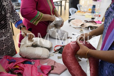 Tamil Apostolate making neck pillows from recyclable cloth.