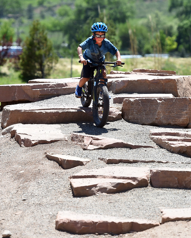 . Oliver Nylen, 7, takes on the BMX course after the competitive races at the 2018 Colorado Burning Can Fest at the Lyons Outdoor Games. For more photos, go to dailycamera.com. Cliff Grassmick  Staff Photographer  June 2, 2018