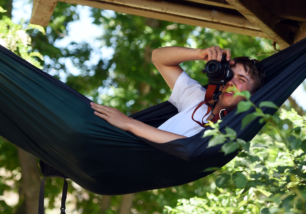 . Rily Frank photographs the kayak competition from his hammock at the 2018 Colorado Burning Can Fest at the Lyons Outdoor Games. For more photos, go to dailycamera.com. Cliff Grassmick  Staff Photographer  June 2, 2018