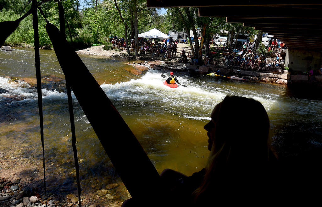 . Katie Fankhouser watches the kayaking from her hammock in the shade at the 2018 Colorado Burning Can Fest at the Lyons Outdoor Games. For more photos, go to dailycamera.com. Cliff Grassmick  Staff Photographer  June 2, 2018