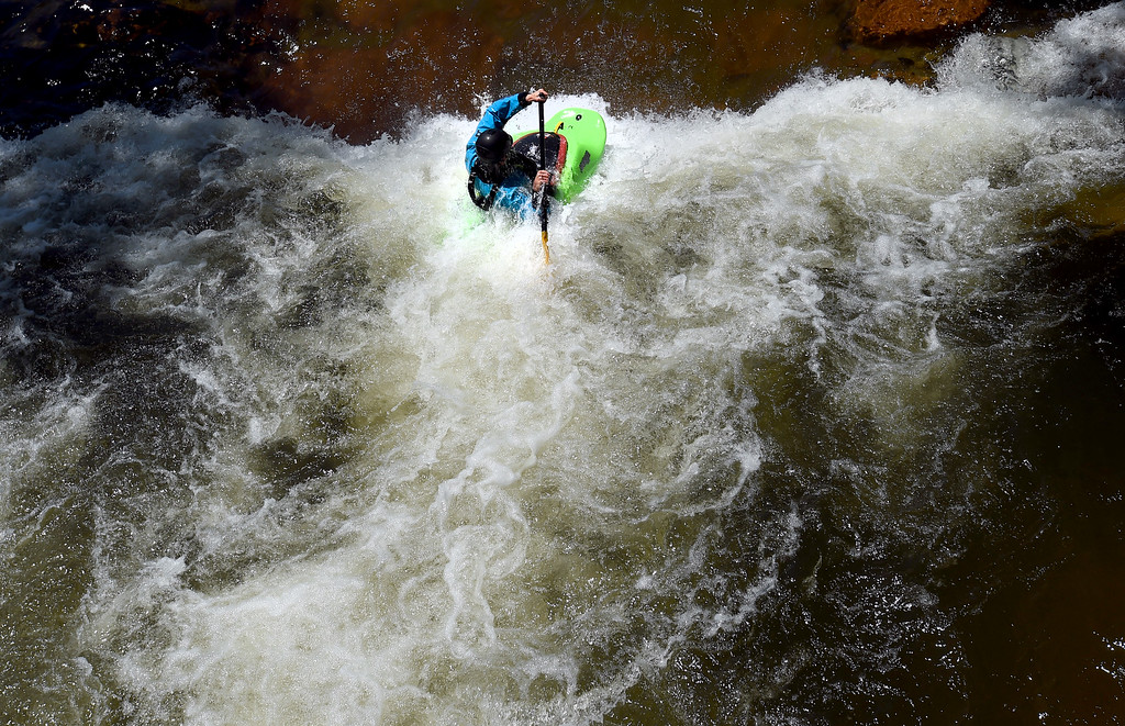 . One of the pro kayakers warms up in the white water at the 2018 Colorado Burning Can Fest at the Lyons Outdoor Games. For more photos, go to dailycamera.com. Cliff Grassmick  Staff Photographer  June 2, 2018