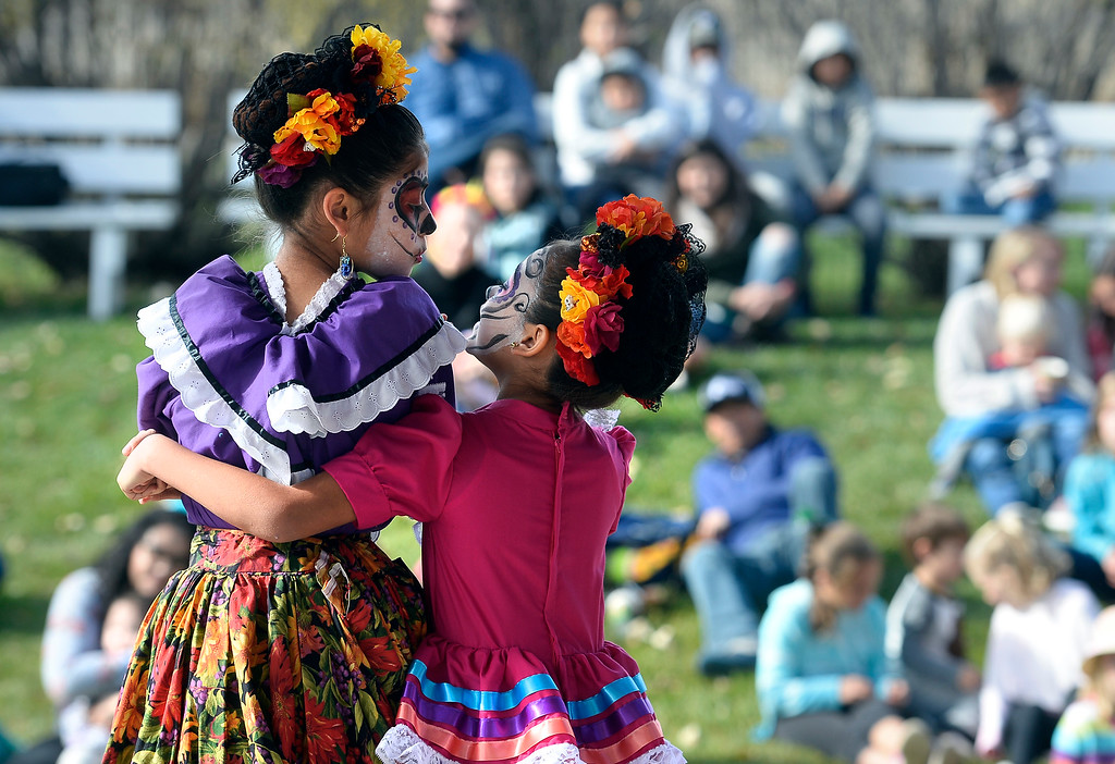. LONGMONT, CO - November 3, 2018:  Liliana Ravenzaha, left, and Anissa Corral, of Fiesta Colorado Dance Company, dance to traditional Mexican music at the celebration.Longmont�s annual Día de los Muertos celebration is the Longmont Museum�s signature event and the largest Day of the Dead celebration in Colorado, attracting more than 6,000 people to the event.  (Photo by Cliff Grassmick/Staff Photographer)