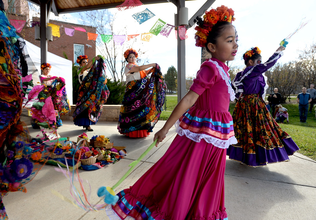 . LONGMONT, CO - November 3, 2018: Anissa Corral dances with Fiesta Colorado Dance Group. Longmont�s annual Día de los Muertos celebration is the Longmont Museum�s signature event and the largest Day of the Dead celebration in Colorado, attracting more than 6,000 people to the event.  (Photo by Cliff Grassmick/Staff Photographer)