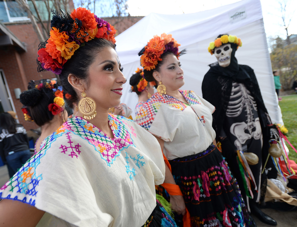 . LONGMONT, CO - November 3, 2018: Angelica Corral Ravenzaha, left, Gabriela Duran, and Jesus Martinez, were part of the Fiesta Colorado Dance Group. Longmont�s annual Día de los Muertos celebration is the Longmont Museum�s signature event and the largest Day of the Dead celebration in Colorado, attracting more than 6,000 people to the event.  (Photo by Cliff Grassmick/Staff Photographer)