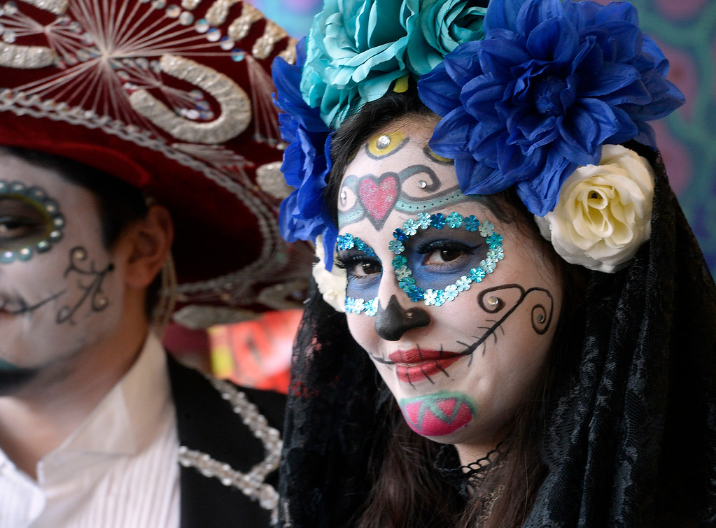 . LONGMONT, CO - November 3, 2018:  Andrew Lucero, left, and Nahomi Reza, display their detailed Day of the Dead look. Longmont�s annual Día de los Muertos celebration is the Longmont Museum�s signature event and the largest Day of the Dead celebration in Colorado, attracting more than 6,000 people to the event.  (Photo by Cliff Grassmick/Staff Photographer)