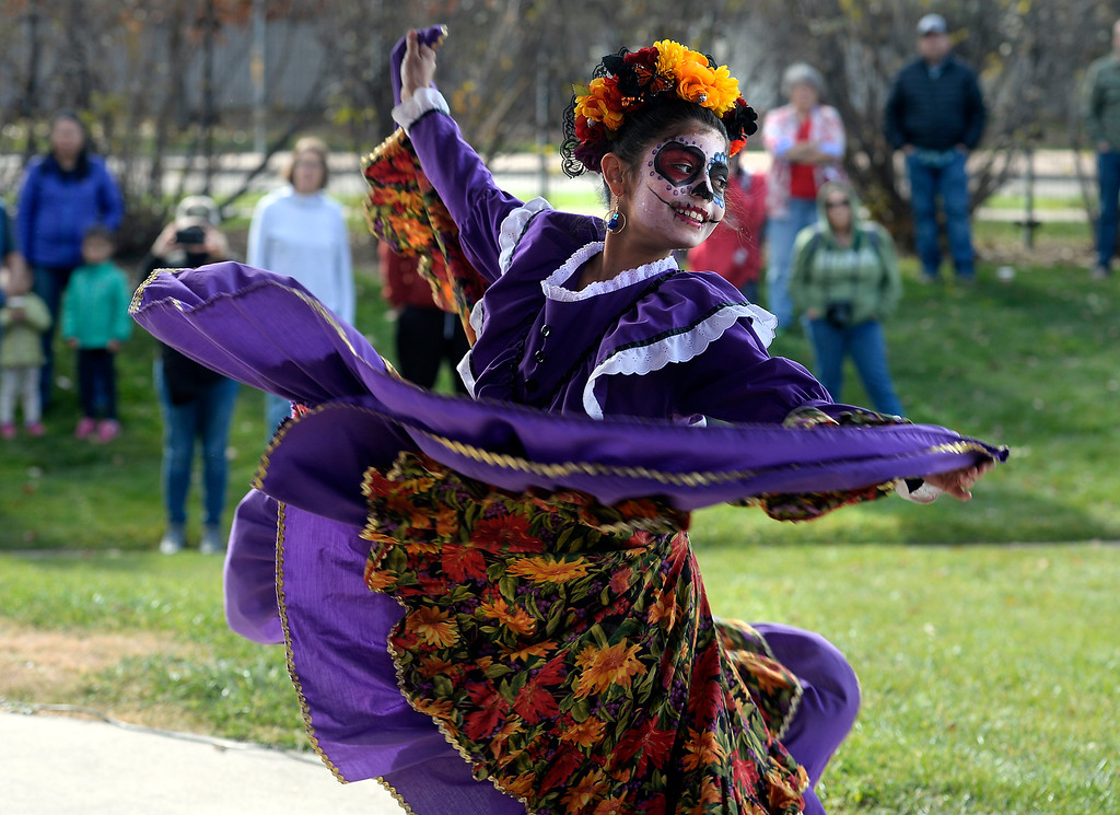 . LONGMONT, CO - November 3, 2018: Liliana Ravenzaha, of Fiesta Colorado Dance Company, dances to traditional Mexican music at the celebration. Longmont�s annual Día de los Muertos celebration is the Longmont Museum�s signature event and the largest Day of the Dead celebration in Colorado, attracting more than 6,000 people to the event.  (Photo by Cliff Grassmick/Staff Photographer)