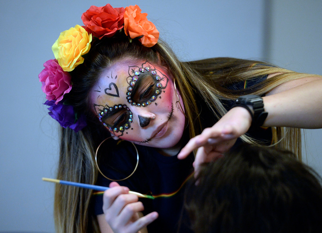 . LONGMONT, CO - November 3, 2018:  Anjelica Medina Vigil paints face for the celebration. Longmont�s annual Día de los Muertos celebration is the Longmont Museum�s signature event and the largest Day of the Dead celebration in Colorado, attracting more than 6,000 people to the event.  (Photo by Cliff Grassmick/Staff Photographer)