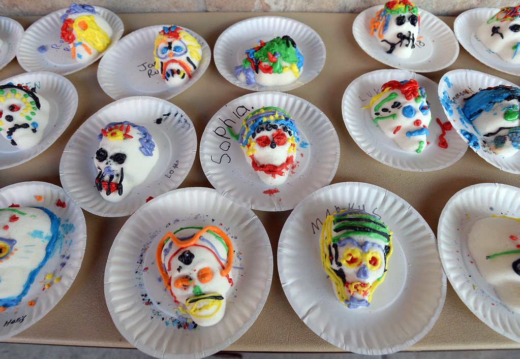 . LONGMONT, CO - November 3, 2018:  Kids got a chance to decorate sugar skulls. Longmont�s annual Día de los Muertos celebration is the Longmont Museum�s signature event and the largest Day of the Dead celebration in Colorado, attracting more than 6,000 people to the event.  (Photo by Cliff Grassmick/Staff Photographer)