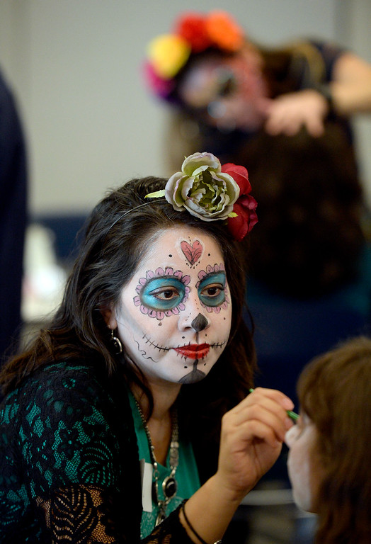 . LONGMONT, CO - November 3, 2018:  Having your face painted was one of the highlights of celebrations. Longmont�s annual Día de los Muertos celebration is the Longmont Museum�s signature event and the largest Day of the Dead celebration in Colorado, attracting more than 6,000 people to the event.  (Photo by Cliff Grassmick/Staff Photographer)