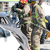 Firefighters work to extract a driver while a student plays dead during a mock accident at the Dieterich School on Tuesday. The event was organized by Dieterich Fire Chief Ross Martin ahead of prom on Friday. Graham Milldrum photo