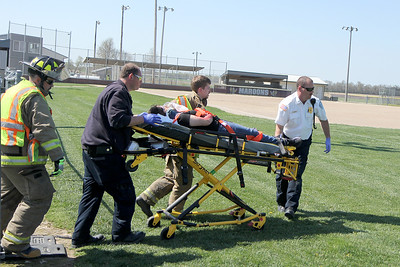 First responders work to evacuate an injured passenger during a mock accident at the Dieterich School on Tuesday. The event was organized by Dieterich Fire Chief Ross Martin ahead of prom on Friday. Graham Milldrum photo
