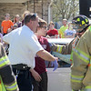 First responders hand over Seth Bohnhoff to law enforcement during a mock accident at the Dieterich School on Tuesday. The event was organized by Dieterich Fire Chief Ross Martin ahead of prom on Friday. Graham Milldrum photo