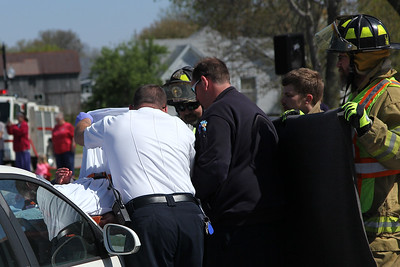 First responders cover Rowdy Ruholl, who played a dead studetn during a mock accident at the Dieterich School on Tuesday. The event was organized by Dieterich Fire Chief Ross Martin ahead of prom on Friday. Graham Milldrum photo