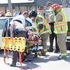 First responders work to evacuate an injured driver during a mock accident at the Dieterich School on Tuesday. The event was organized by Dieterich Fire Chief Ross Martin ahead of prom on Friday. Graham Milldrum photo