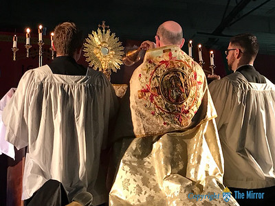 EUCHARISTIC ADORATION—Bishop Edward M. Rice led Eucharistic Adoration March 24 during the 25th Annual Diocesan Youth Conference held in the West Plains Civic Center with 437 youth and adults. (Photo by Margie Black/The Mirror)